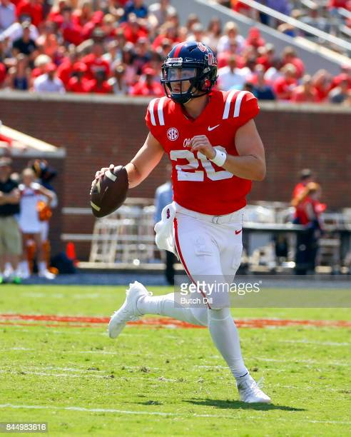 Quarterback Shea Patterson of the Mississippi Rebels rolls out to pass against the Tennessee Martin Skyhawks during the first quarter of an NCAA...