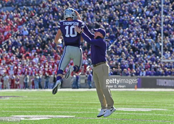 Quarterback Skylar Thompson of the Kansas State Wildcats celebrates with head coach Chris Klieman after scoring a touchdown against the Oklahoma...