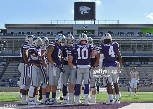 Quarterback Skylar Thompson of the Kansas State Wildcats huddles with the offense against the Texas Tech Red Raiders during the first half at Bill...