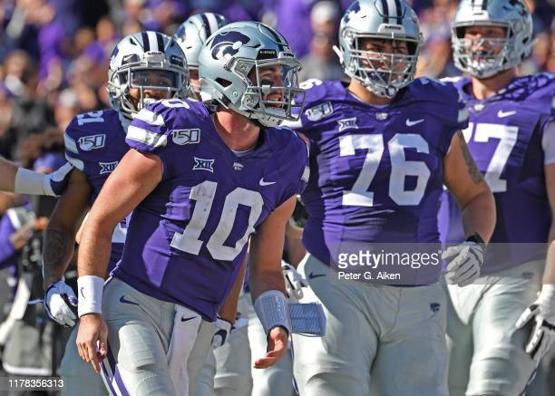 Quarterback Skylar Thompson of the Kansas State Wildcats reacts after scoring a touchdown against the Oklahoma Sooners during the first half at Bill...