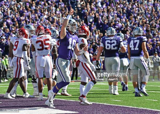 Quarterback Skylar Thompson of the Kansas State Wildcats reacts after scoring a touchdown against the Oklahoma Sooners during the second half at Bill...
