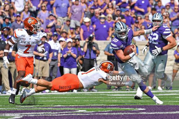 Quarterback Skylar Thompson of the Kansas State Wildcats rushes down field against linebacker Brandon Perce of the Bowling Green Falcons during the...