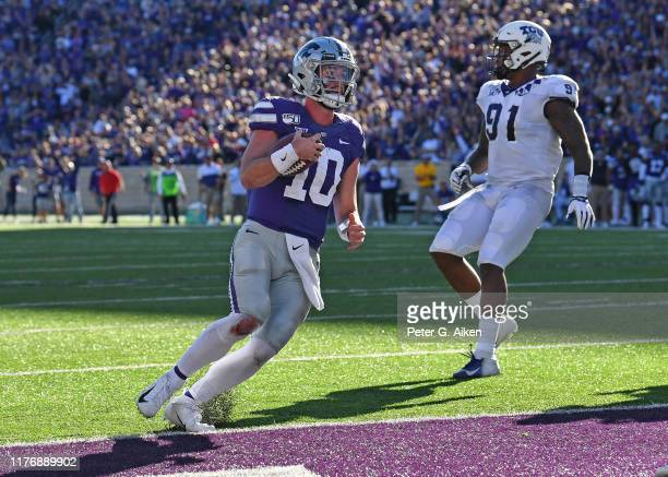 Quarterback Skylar Thompson of the Kansas State Wildcats rushes for a touchdown against the TCU Horned Frogs during the second half at Bill Snyder...