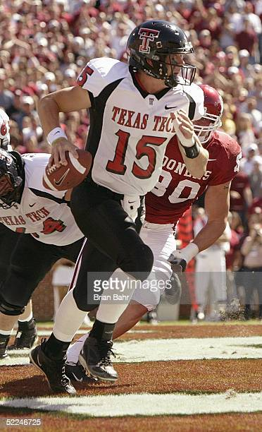 Quarterback Sonny Cumbie of the Texas Tech Red Raiders runs against the Oklahoma Sooners on October 2 2004 at Memorial Stadium in Norman Oklahoma The...