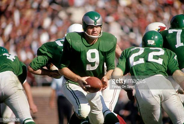 Quarterback Sonny Jurgensen of the Philadelphia Eagles turns to hand the ball off to a running back against the St Louis Cardinals during an NFL game...