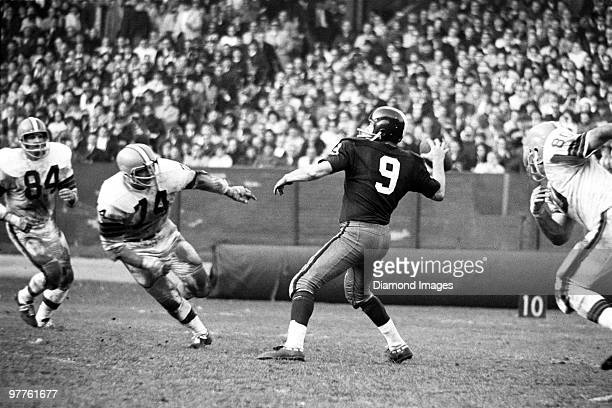 Quarterback Sonny Jurgensen of the Washington Redskins throws a pass while under pressure from Paul Wiggin Dick Modzelewski and Bill Glass of the...