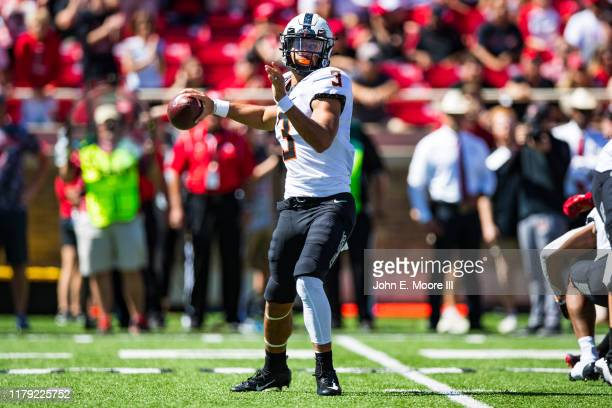 Quarterback Spencer Sanders of the Oklahoma State Cowboys passes the ball during the second half of the college football game against the Texas Tech...