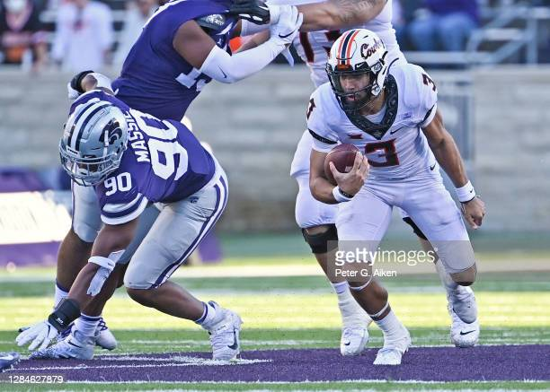 Quarterback Spencer Sanders of the Oklahoma State Cowboys runs down the field during the first half against the Kansas State Wildcats at Bill Snyder...