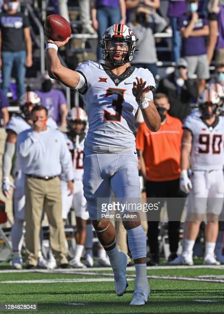 Quarterback Spencer Sanders of the Oklahoma State Cowboys throws a pass during the first half against the Kansas State Wildcats at Bill Snyder Family...