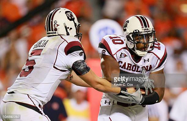 Quarterback Stephen Garcia and Brian Maddox of the South Carolina Gamecocks against the Auburn Tigers at JordanHare Stadium on September 25 2010 in...