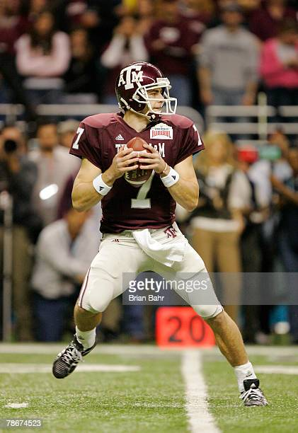 Quarterback Stephen McGee of the Texas AM Aggies drops back to pass against the Penn State Nittany Lions in the first quarter during the Valero Alamo...