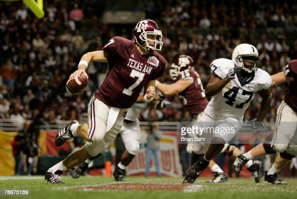 Quarterback Stephen McGee of the Texas AM Aggies runs the ball out of the endzone with left end Josh Gaines of the Penn State Nittany Lions in...