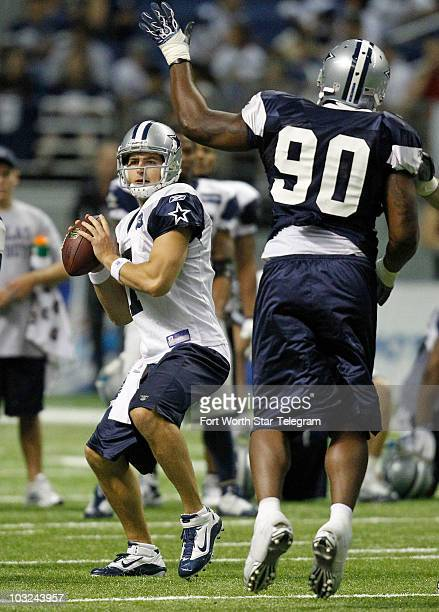 Quarterback Stephen McGee throws under pressure from Jay Ratliff as the Dallas Cowboys continue their training camp at the Alamodome in San Antonio...