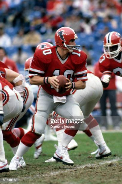 Quarterback Steve Bartkowski of the Atlanta Falcons turns to hand the ball off during a game on December 10 1983 against the Buffalo Bills at Atlanta...
