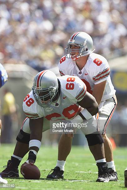 Quarterback Steve Bellisari of the Ohio State Buckeyes waits for the snap from center LeCharles Bentley against the UCLA Bruins during the game at...
