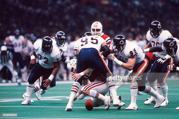 Quarterback Steve Grogan, of the New England Patriots, fumbles the ball as Richard Dent, of the Chicago Bears hits him during Super Bowl XX on...