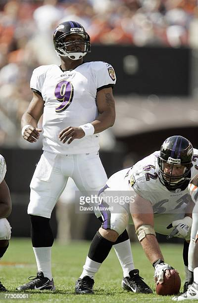 Quarterback Steve McNair of the Baltimore Ravens looks down the field as center Mike Flynn gets ready on the line during the NFL game against the...
