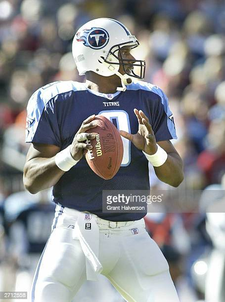 Quarterback Steve McNair of the Tennessee Titans drops back to pass against the Miami Dolphins during a NFL game on November 9 2003 at The Coliseum...
