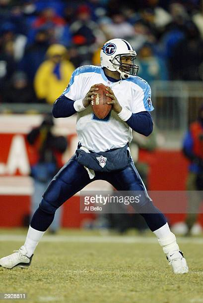 Quarterback Steve McNair of the Tennessee Titans drops back to pass against the New England Patriots in the AFC divisional playoffs on January 10...