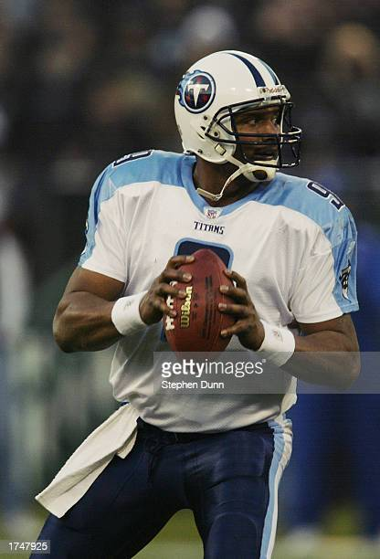 Quarterback Steve McNair of the Tennessee Titans looks for a receiver during the AFC Championship game against the Oakland Raiders at Network...