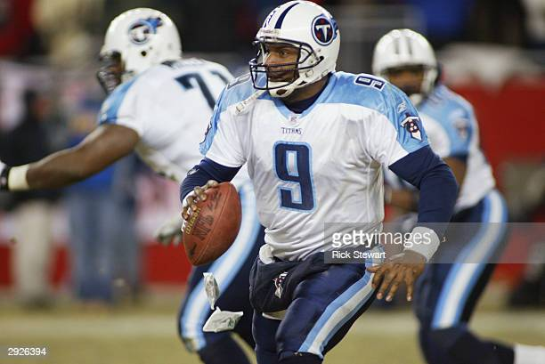 Quarterback Steve McNair of the Tennessee Titans rolls out of the pocket during the game against the New England Patriots in the AFC divisional...