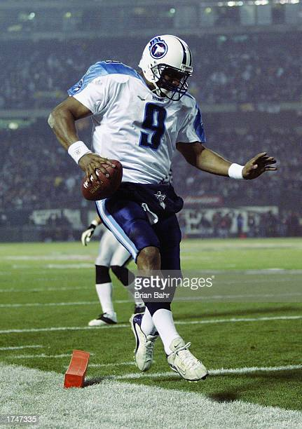 Quarterback Steve McNair of the Tennessee Titans scores in the third quarter of the AFC Championship game against the Oakland Raiders at Network...