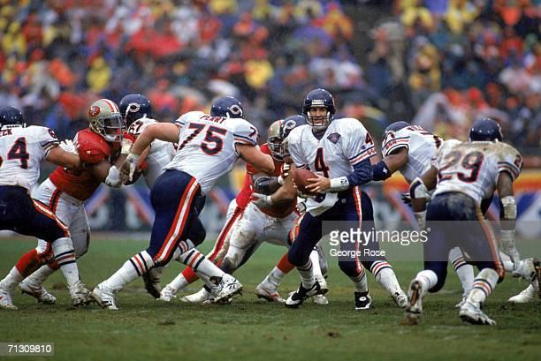 Quarterback Steve Walsh of the Chicago Bears looks to hand off the ball during a 1994 NFC Divisional Playoff game against the San Francisco 49ers at...