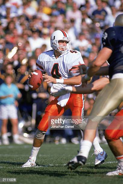 Quarterback Steve Walsh of the University of Miami Hurricanes looks to pass during a game against Notre Dame Fighting Irish on October 15, 1988 in...