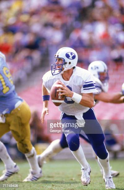 Quarterback Steve Young of the Brigham Young University Cougars runs with the ball as he looks down field for a receiver furing a 1983 NCAA game
