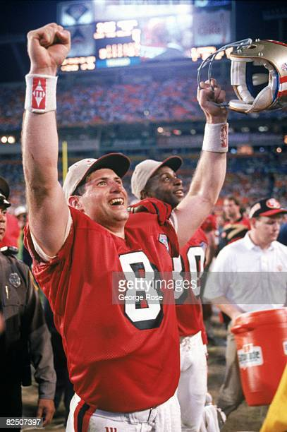 Quarterback Steve Young of the San Francisco 49ers celebrates following their Super Bowl XXIX against the San Diego Chargers at Joe Robbie Stadium on...