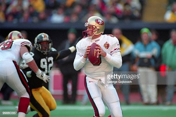 Quarterback Steve Young of the San Francisco 49ers looks to pass during a game against the Pittsburgh Steelers at Three Rivers Stadium on December 15...