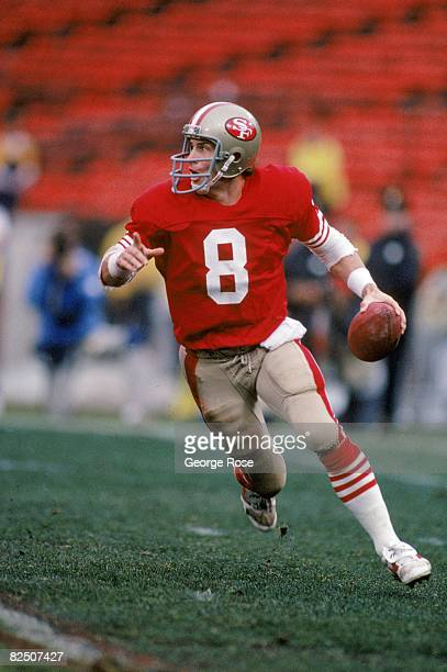 Quarterback Steve Young of the San Francisco 49ers looks to pass against the Minnesota Vikings defense during the 1987 NFC Divisional Playoffs at...