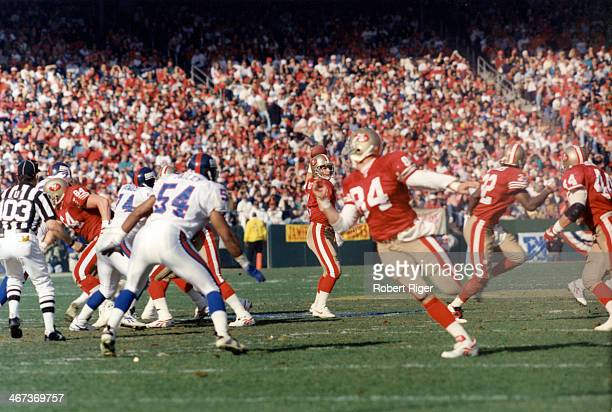 Quarterback Steve Young of the San Francisco 49ers looks to throw the ball during the game against the New York Giants during the 1993 NFC Divisional...