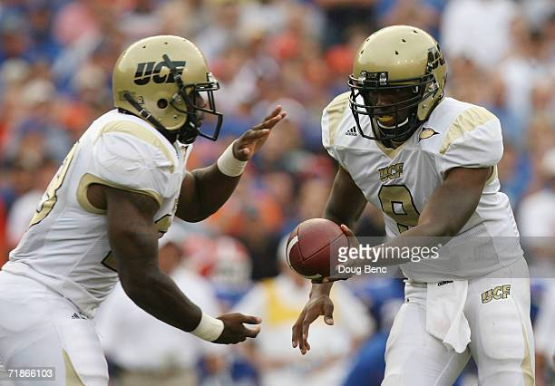 Quarterback Steven Moffett of the University of Central Florida Golden Knights hands off a pass to Jason Peters against the University of Florida...