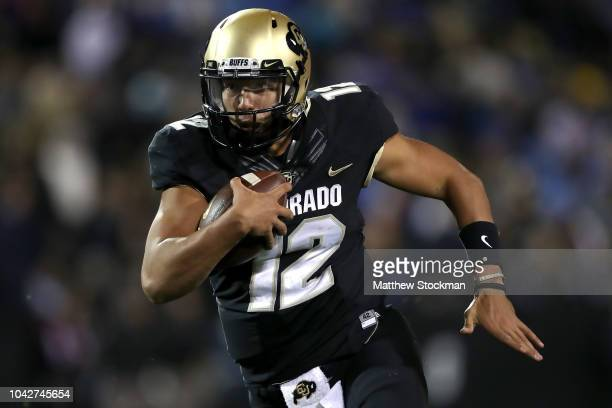 Quarterback Steven Montez of the Colorado Buffaloes carries the ball for a touchdown ion the fourth quarter against the UCLA Bruins at Folsom Field...