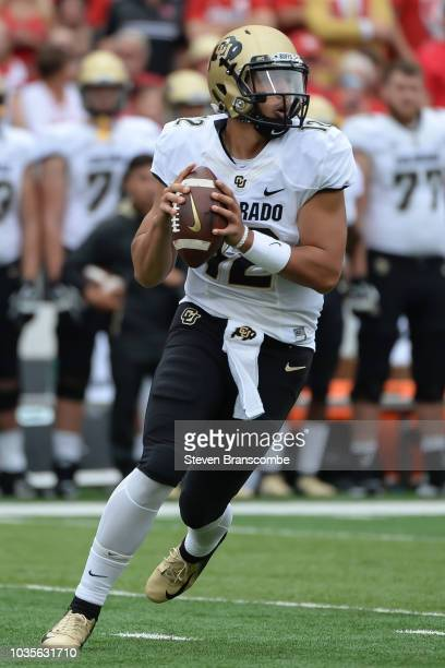Quarterback Steven Montez of the Colorado Buffaloes drops back to pass against the Nebraska Cornhuskers at Memorial Stadium on September 8 2018 in...