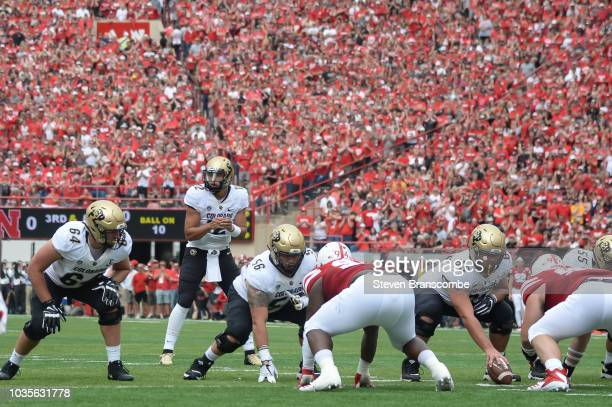 Quarterback Steven Montez of the Colorado Buffaloes looks over the line in the game against the Nebraska Cornhuskers at Memorial Stadium on September...