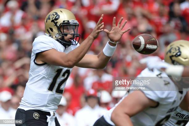 Quarterback Steven Montez of the Colorado Buffaloes takes a snap against the Nebraska Cornhuskers at Memorial Stadium on September 8 2018 in Lincoln...
