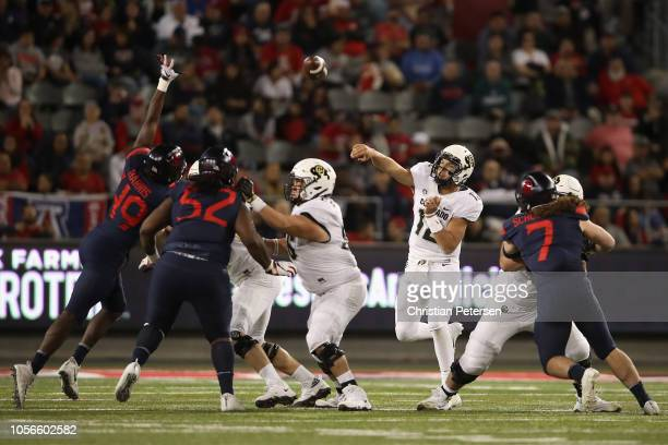 Quarterback Steven Montez of the Colorado Buffaloes throws a pass during the first half of the college football game against the Arizona Wildcats at...