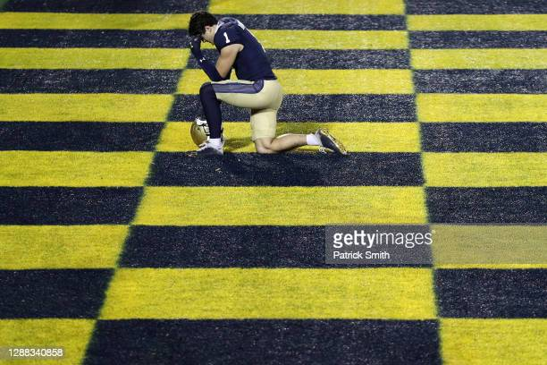 Quarterback Tai Lavatai of the Navy Midshipmen has a moment to himself before playing against the Memphis Tigers at Navy-Marine Corps Memorial...