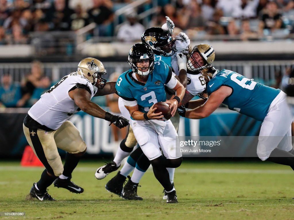 Quarterback Tanner Lee #3 of the Jacksonville Jaguars avoids being tackles during a preseason game against the New Orleans Saints at TIAA Bank Field on August 9, 2018 in Jacksonville, Florida. The Saints defeated the Jaguars 24 to 20.
