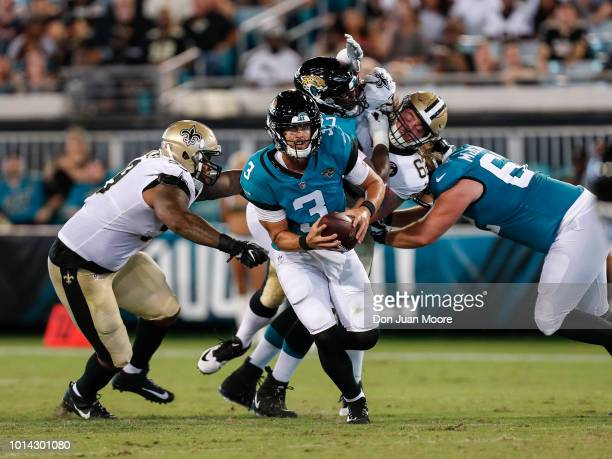 Quarterback Tanner Lee of the Jacksonville Jaguars avoids being tackles during a preseason game against the New Orleans Saints at TIAA Bank Field on...