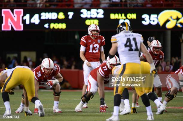 Quarterback Tanner Lee of the Nebraska Cornhuskers comes to the line against the Iowa Hawkeyes at Memorial Stadium on November 24 2017 in Lincoln...