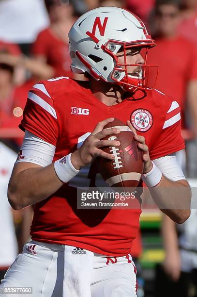 Quarterback Tanner Lee of the Nebraska Cornhuskers drops back to pass against the Rutgers Scarlet Knights at Memorial Stadium on September 23 2017 in...