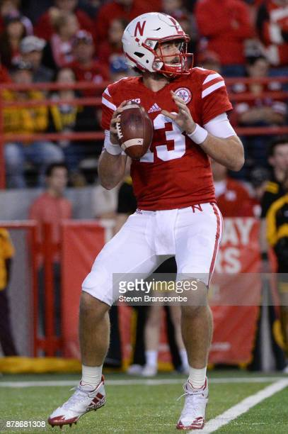 Quarterback Tanner Lee of the Nebraska Cornhuskers drops back to pass against the Iowa Hawkeyes at Memorial Stadium on November 24 2017 in Lincoln...
