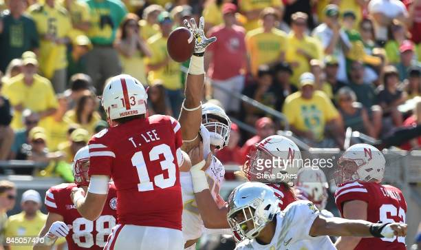 Quarterback Tanner Lee of the Nebraska Cornhuskers has his pass tipped at the line during the third quarter of the game against the Oregon Ducks at...