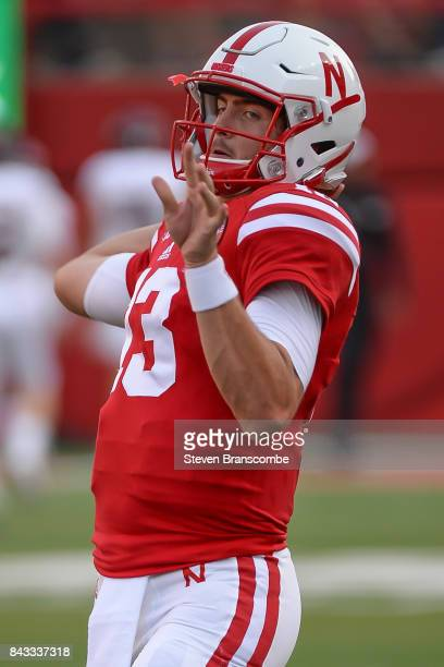 Quarterback Tanner Lee of the Nebraska Cornhuskers warms up before the game against the Arkansas State Red Wolves at Memorial Stadium on September 2...