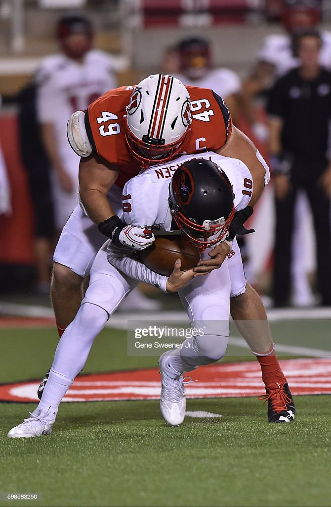 Quarterback Tannon Pedersen #10 of the Southern Utah Thunderbirds, is sacked in the fourth quarter of their 24-0 loss by Hunter Dimick #49 of the Utah Utes at Rice-Eccles Stadium on September 1, 2016 in Salt Lake City, Utah.
