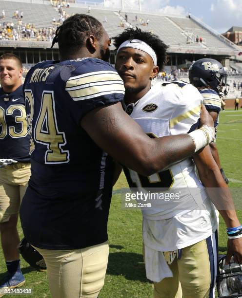 Quarterback TaQuon Marshall of the Georgia Tech Yellow Jackets and defensive tackle Amir Watts of the Pittsburgh Panthers embrace after the game at...