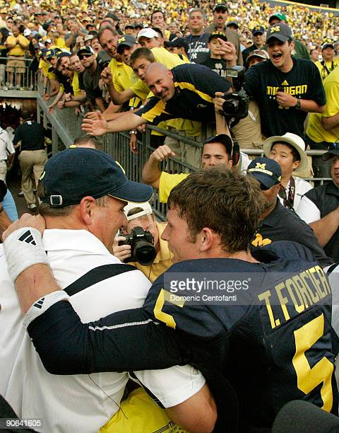Quarterback Tate Forcier embraces head coach Rich Rodriguez as they approach the tunnel after beating Notre Dame 38-34 at Michigan Stadium on...